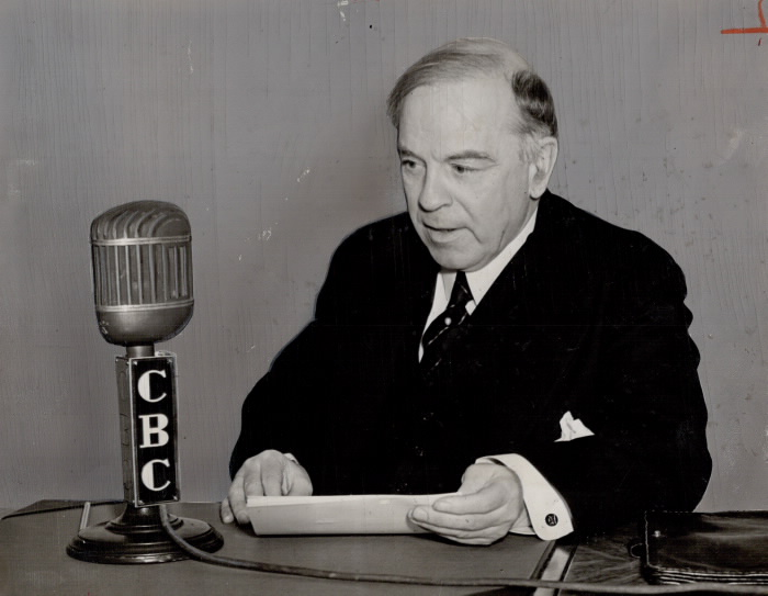 Photograph of Prime Minister William Lyon Mackenzie King speaking into a CBC microphone