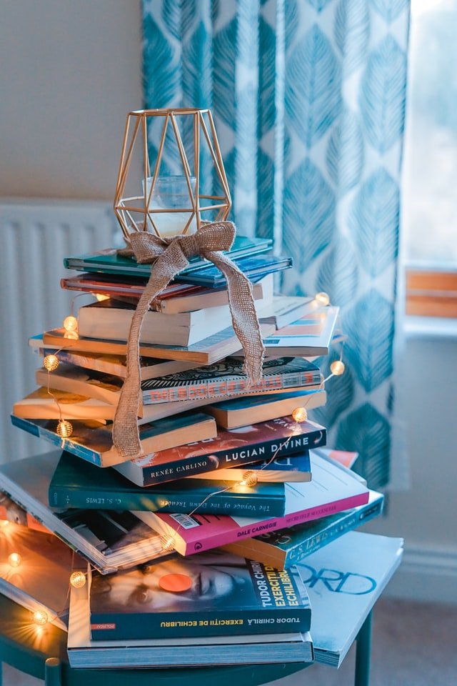 Wire tree atop a stack of books