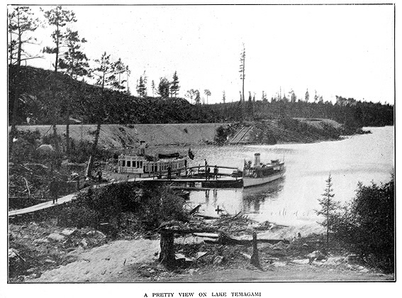 Lake with jetty and boats and subtitle A pretty view on Lake Temagami