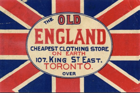 Trade card for The Old England clothing store with logo over Union Jack flag