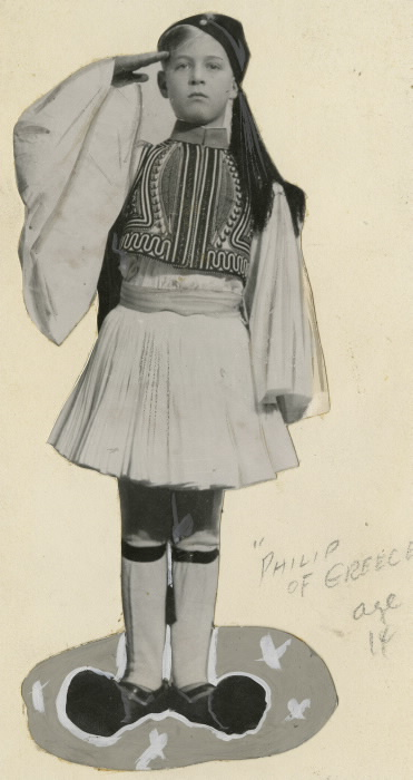 Cut out of young boy saluting in traditional outfit with pencil lettering reading Philip of Greece age 14