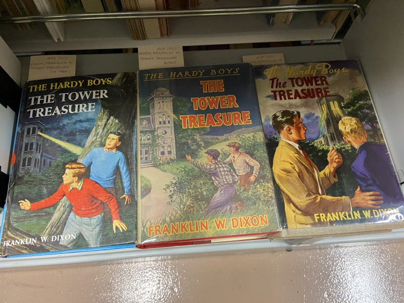 Three editions of The Hardy Boys book The Tower Treasure