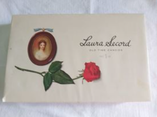 Cover of box of chocolates with portrait of young lady and rose and text reading Laura Secord
