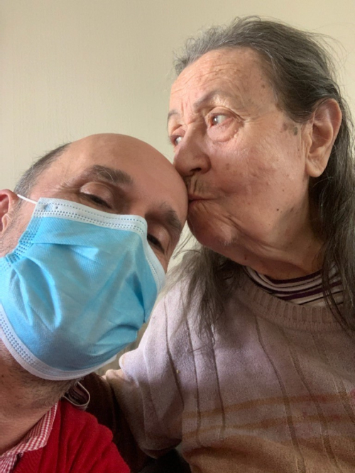 Bill V (in mask)  and Mom kissing him.