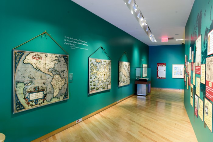 Interior of gallery with old maps on walls