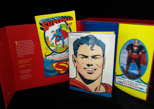 Superman: Masterpiece Edition set open to show cover with full-page illustration and collectible figurine
