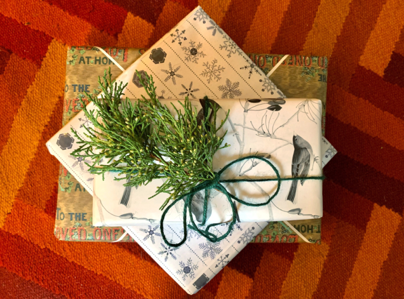 Photograph of three gifts wrapped with paper from TPL's Special Collections