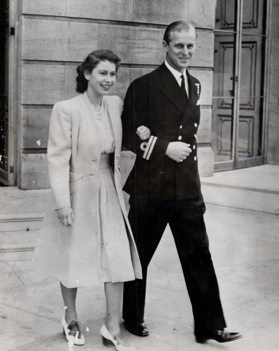 Woman and man walking arm in arm in formal attire