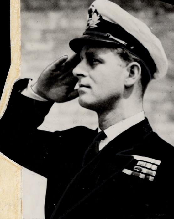 Prince Philip saluting in military uniform