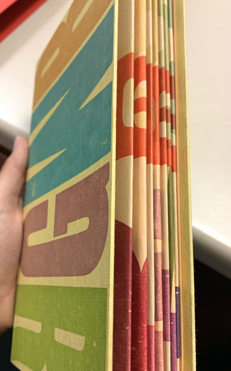 Book covered in colourful printed letters
