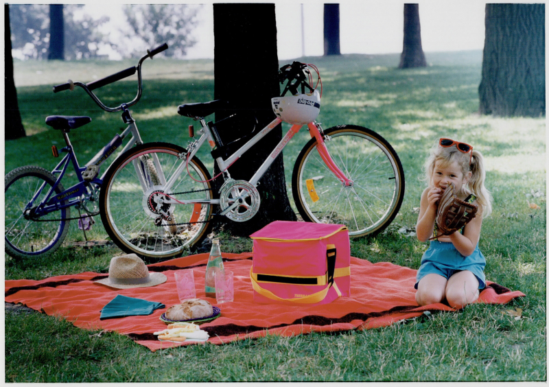 Bicycles; sandwiches; a blanket and a shady tree are the ingredients of an old-fashioned city picnic.
