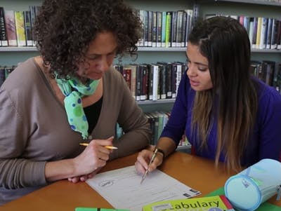Adult learner receiving support from a TPL volunteer.