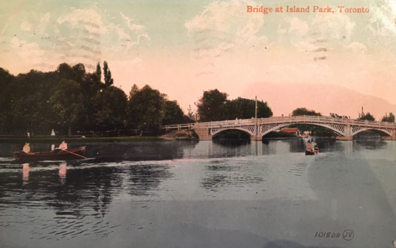 Vintage postcard showing rowers and canoes approaching bridge and words Bridge at Island Park Toronto