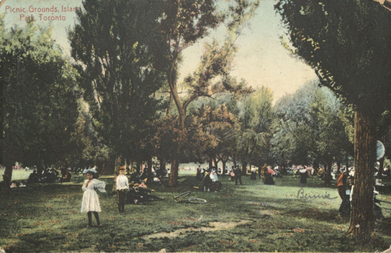 Postcard of children and others in park with words in corner of postcard reading Picnic Grounds Island Park Toronto