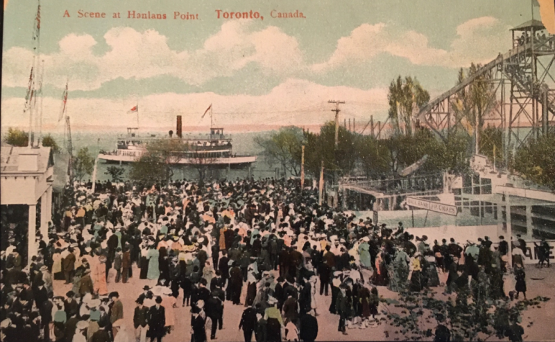 Vintage postcard of large crowd by water where a boat is near and words reading A Scene at Hanlans Point Toronto Canada