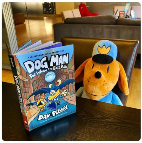 Dog Man doll reading book