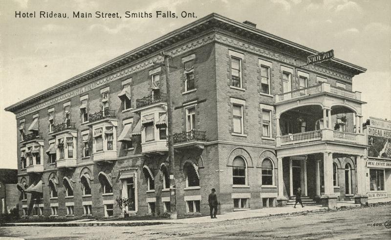 Brick hotel on corner of street.