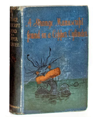 A closed cloth-covered book features a cartoonish sea monster emerging from water, holding a copper-coloured cylinder in its mouth.