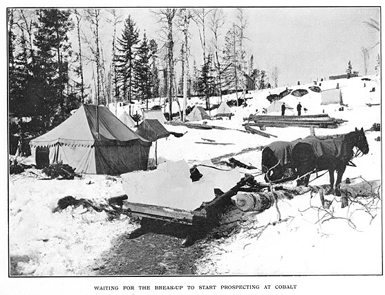 Winter scene of mining camp with horse sled
