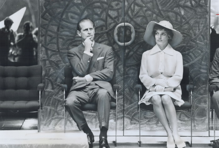 Prince Philip and Margaret Trudeau at formal event sitting on chairs beside each other