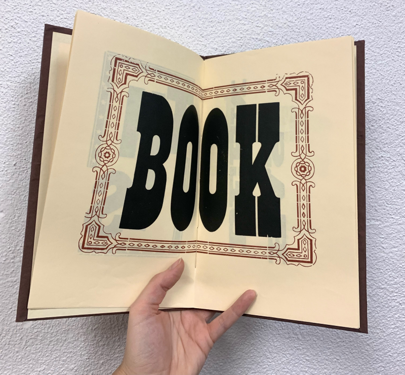 """Inner page of """"This Book"""" by Brandstead Press displaying large format type"""