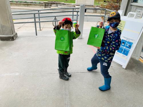 Kids picking up activity kits