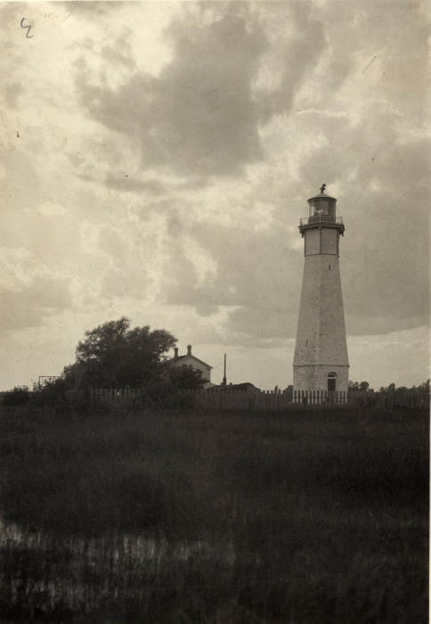 Vintage photo of lighthouse with dark clouds in background