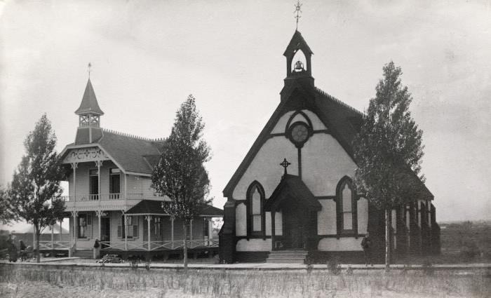 Two church buildings in open field