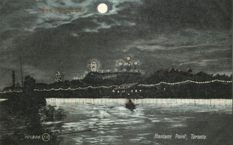 Postcard of string lights on coast and words reading Hanlans Point Toronto
