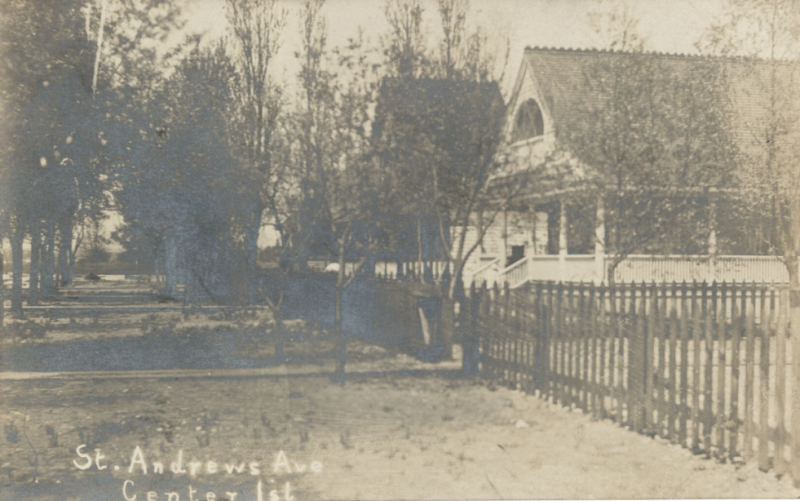 Vintage postcard with a road and a house behind trees and the words St. Andrews Ave Center Isl