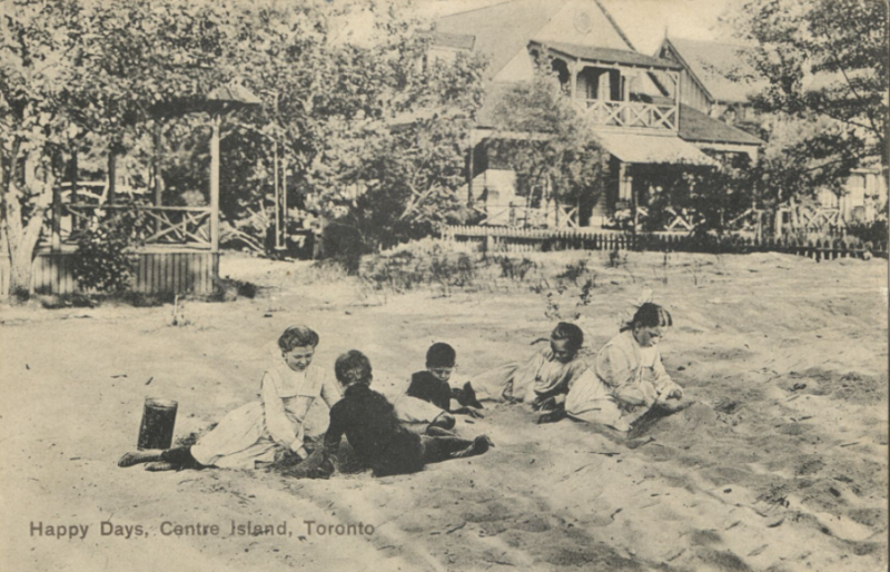 Vintage postcard of children playing on beach with house in background and words reading Happy Days Centre Island Toronto