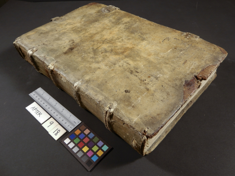 Old book with blank cover next to measurement tools and the text After and a date