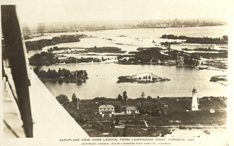 Vintage postcard showing aerial view with lighthouse and other landmarks and text reading Aeroplane view over lagoon from lighthouse point  Toronto Ontario Copyright canada 1919 by Cnadian Post Card Company Toronto
