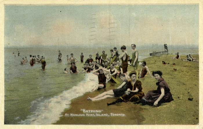 Postcard showing bathers by beach and words Bathing at Hanlans point  Island  Toronto