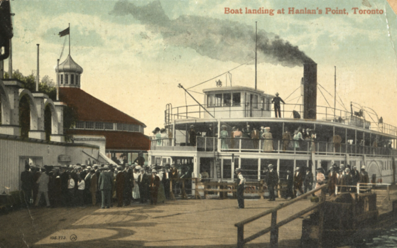 Illustrated postcard of ferry with smoke coming out and people crowded nearby and words reading Boat landing at Hanlan's Point Toronto
