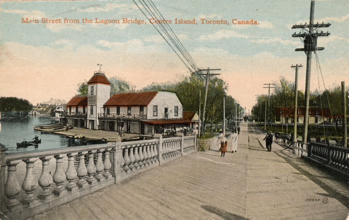 Vintage postcard of bridge and dock and words reading Main Street from the Lagoon Bridge Centre Island Toronto Canada