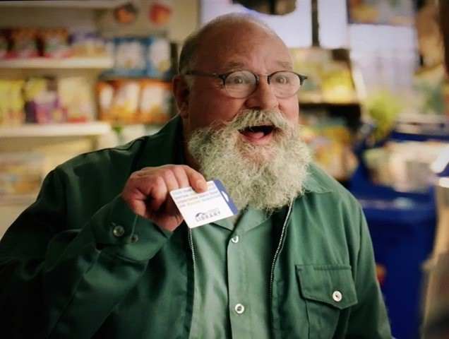 Kims Convenience character holding TPL library card